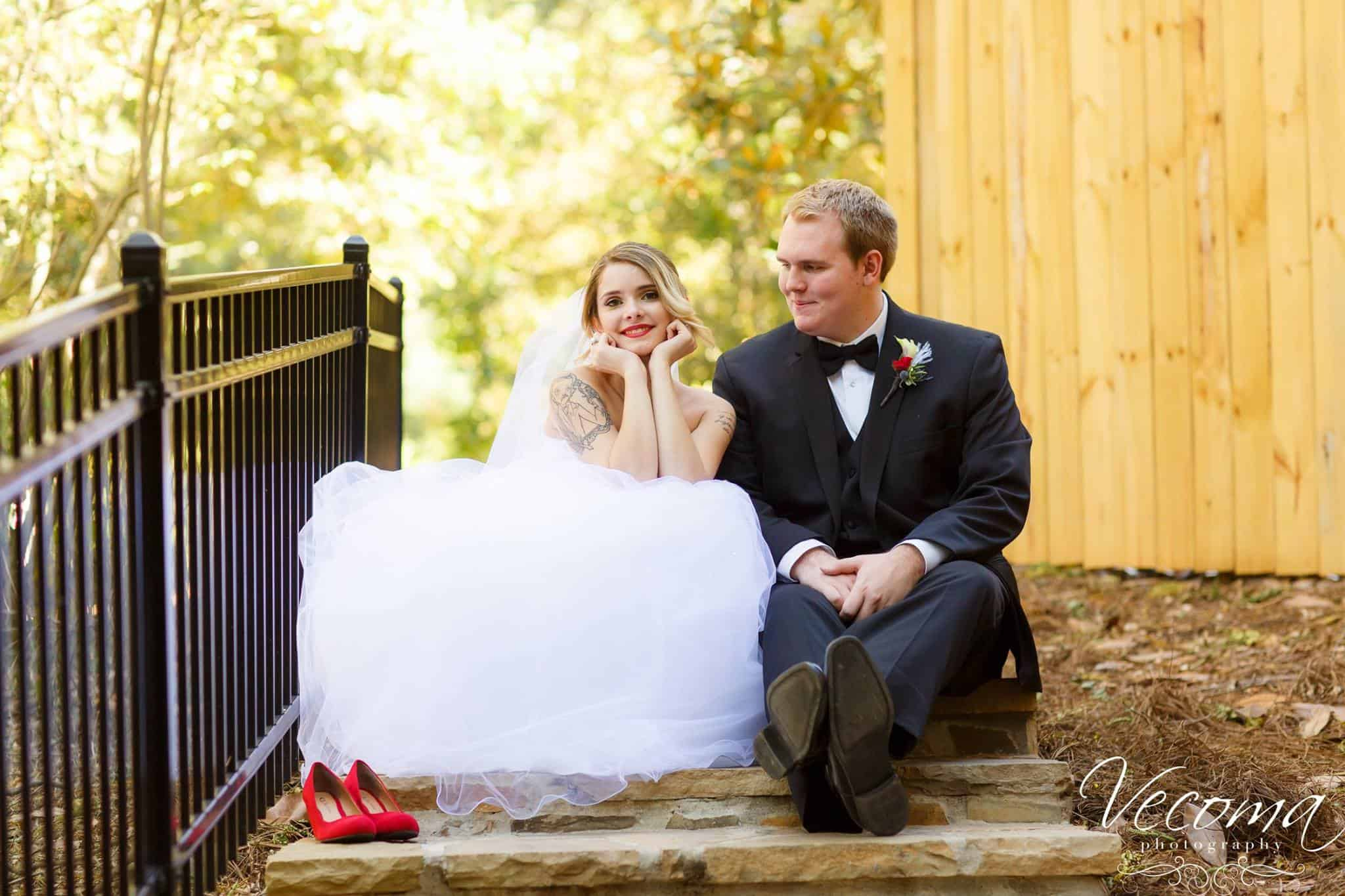 Bride and Groom sit on the steps