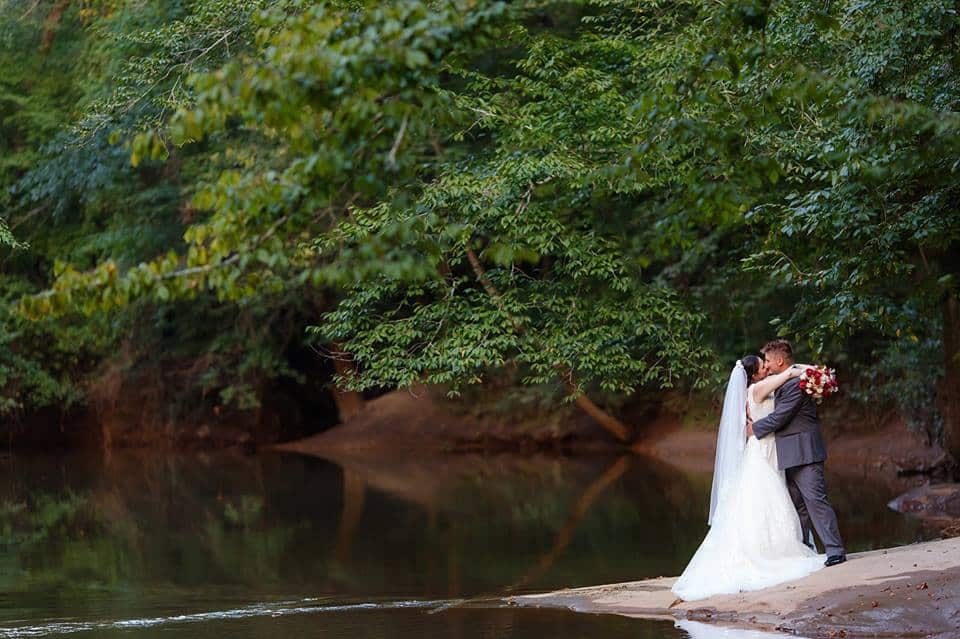 Bride and Groom Embracing on the River