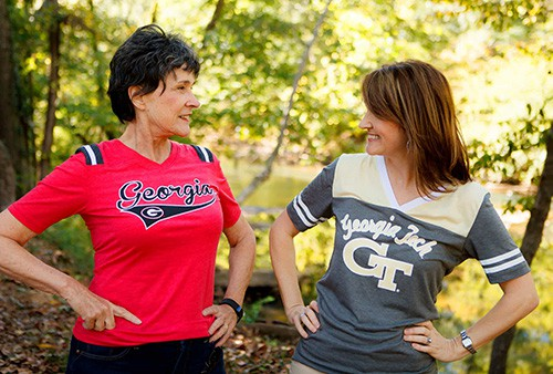 Mother and Daughter hands on hip red shirt football fans Georgia Tech colors gold and grey
