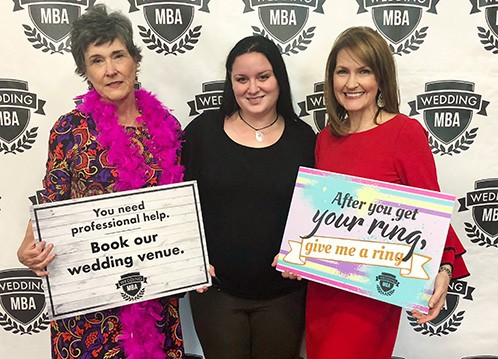 Trio of Vecoma Wedding Team at MBA Wedding Conference in Las Vegas, Mother wearing bright fuschia boa