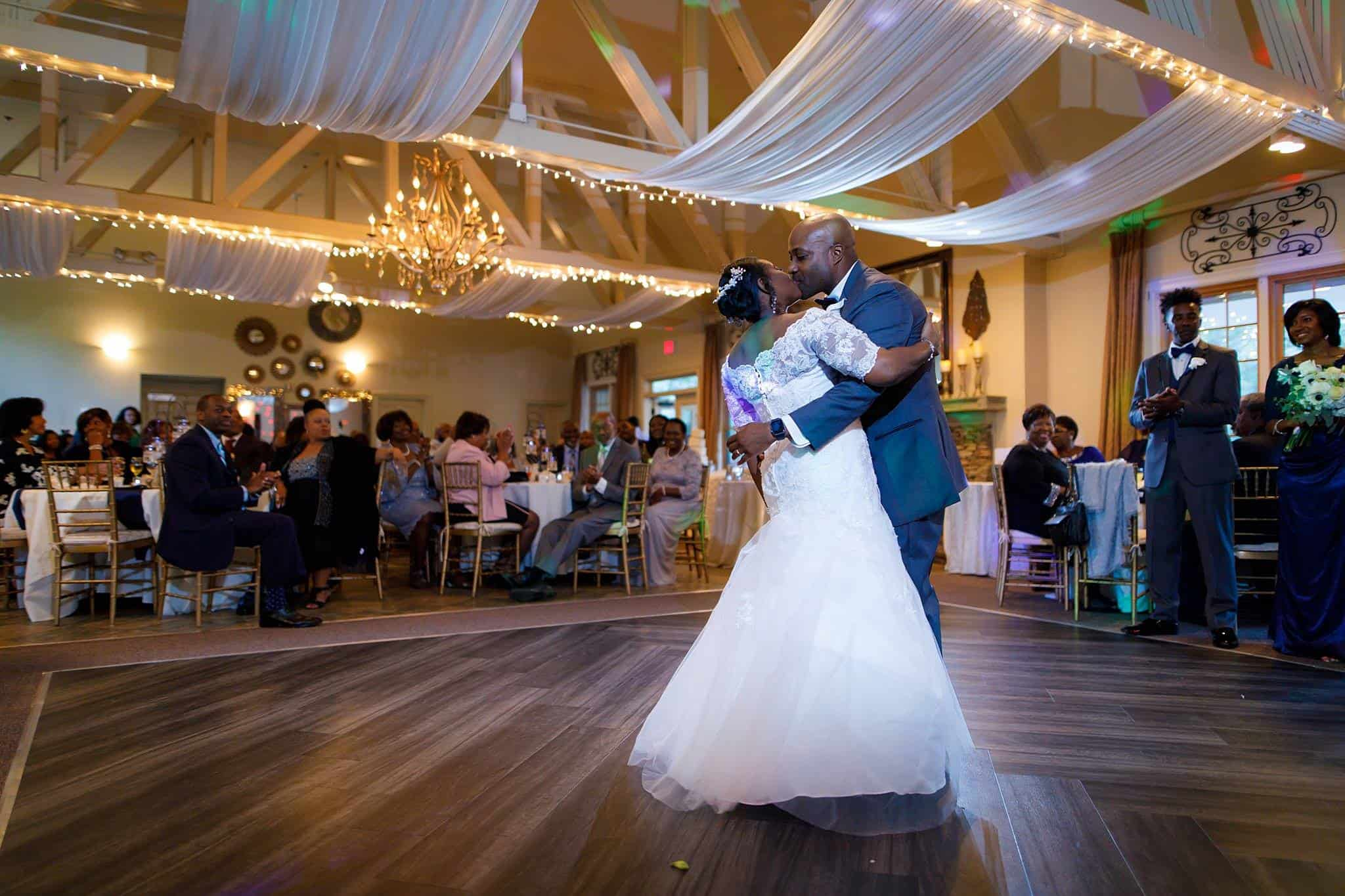 bride and groom share romantic kiss during their first dance