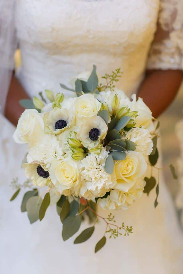 Bridal bouquet of white roses and eucalyptus