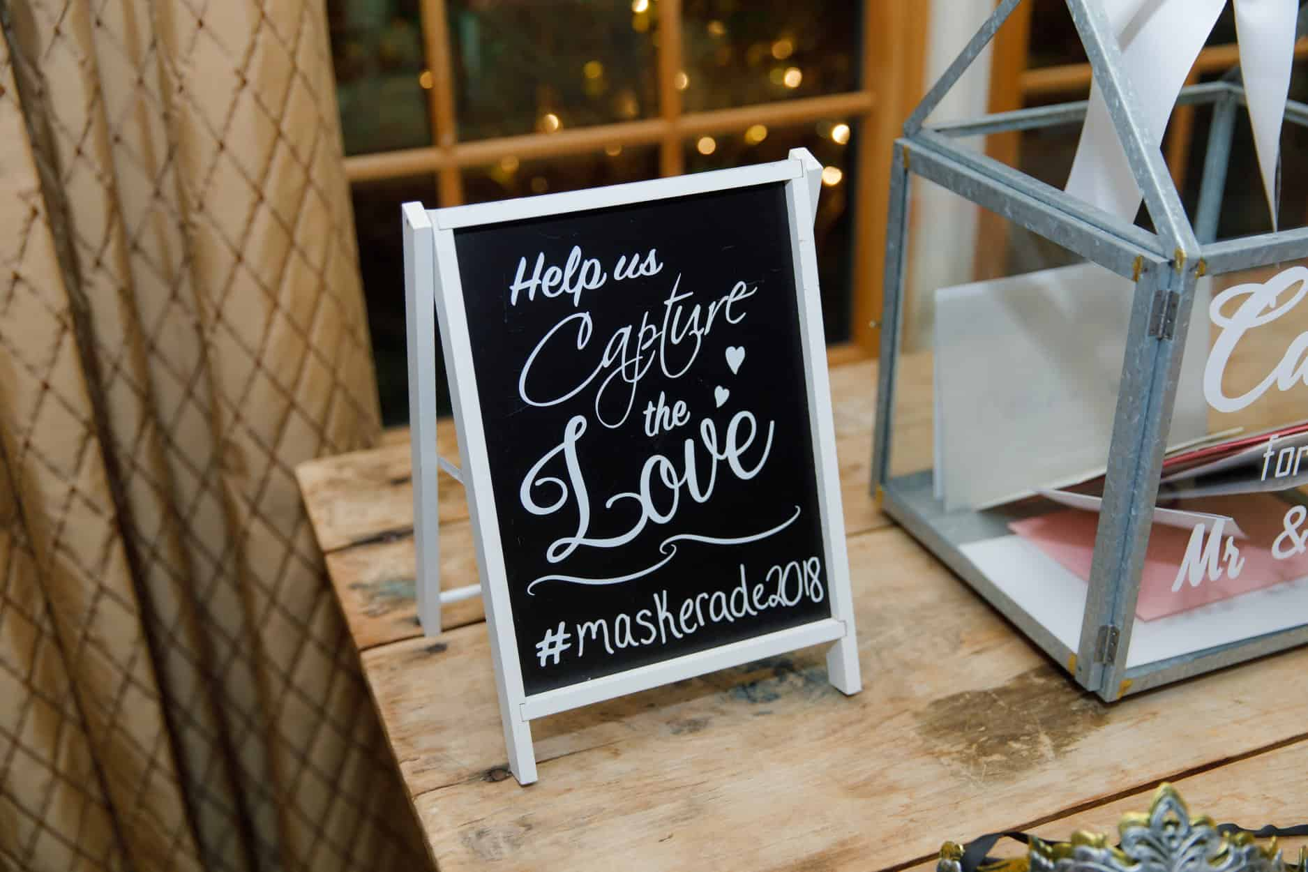 Wedding hashtag on small chalkboard on table next to gift cards