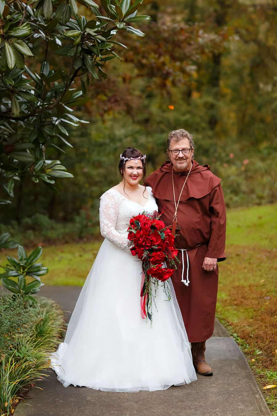 Medieval bride poses with father dressed as Friar