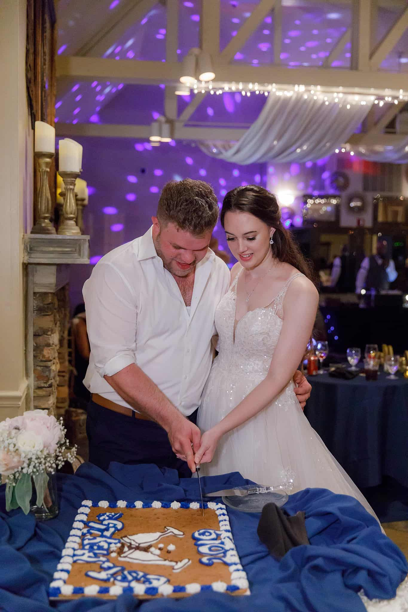 bride and groom cut cookie cake