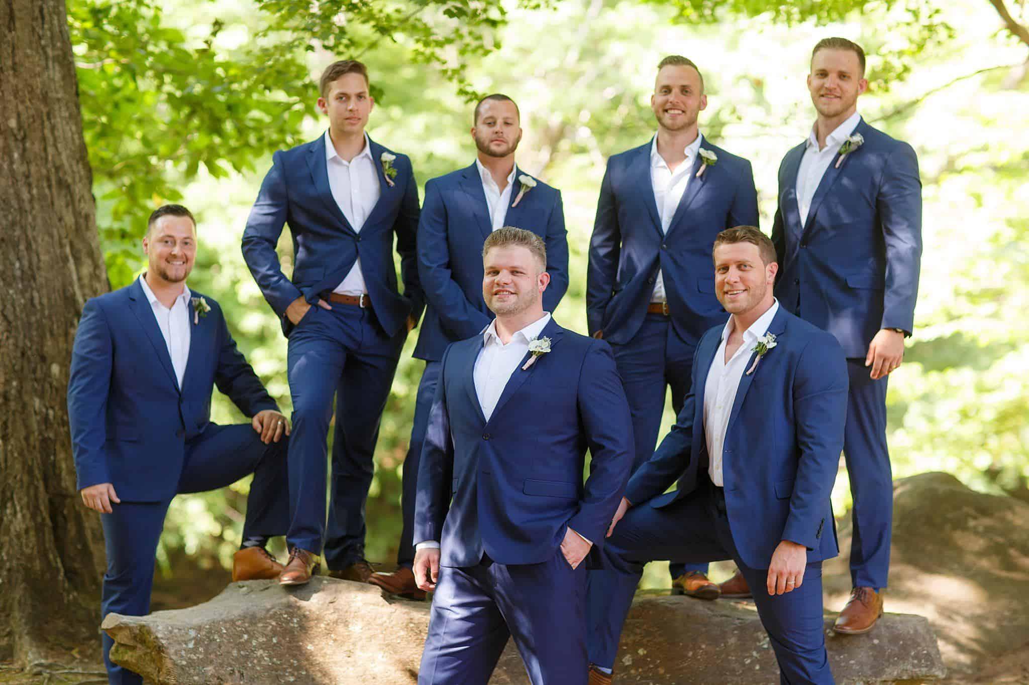 Handsome groomsmen in navy blue suits