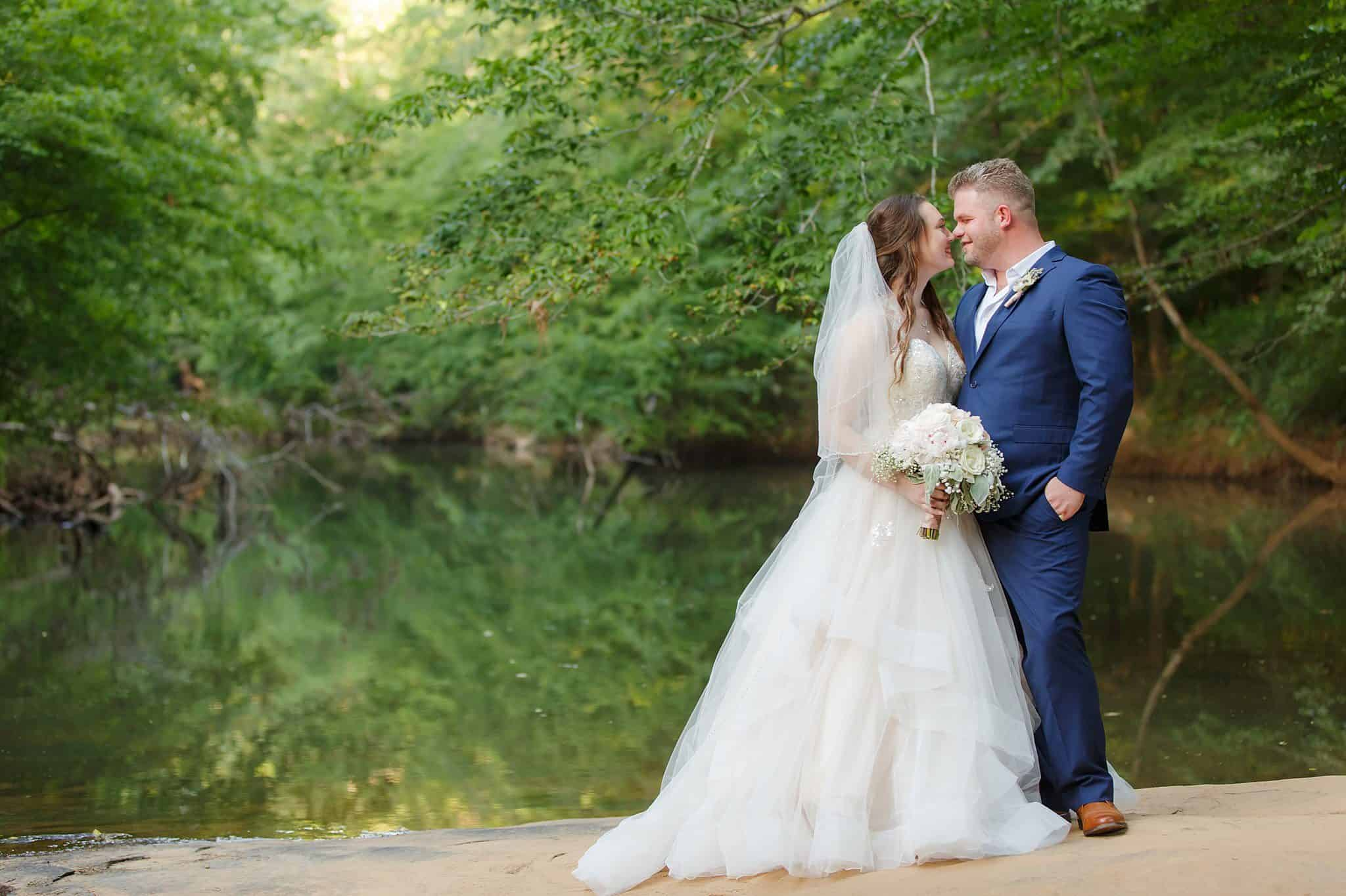 bride and groom on river