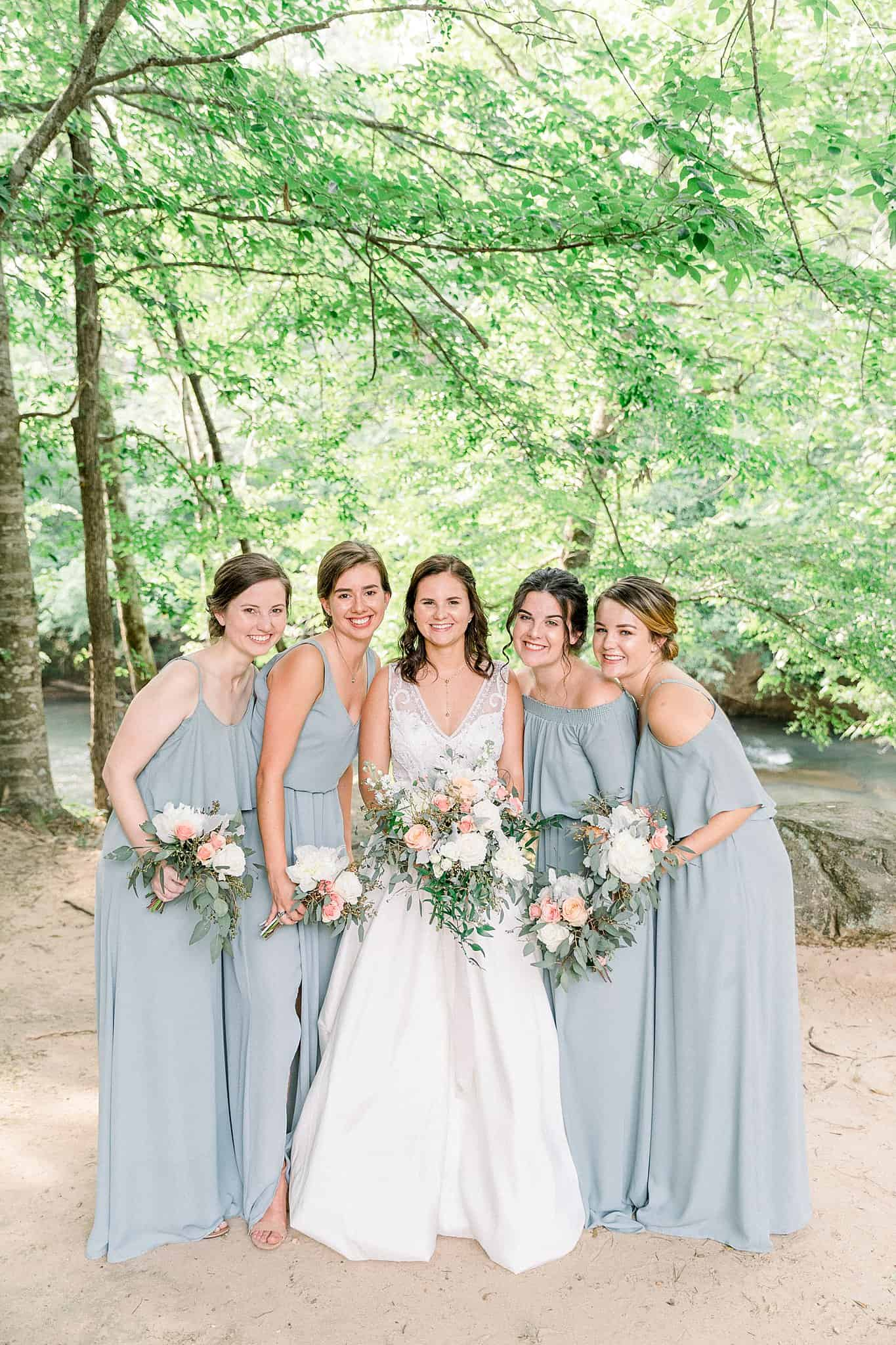 Bridesmaids in light gray gowns