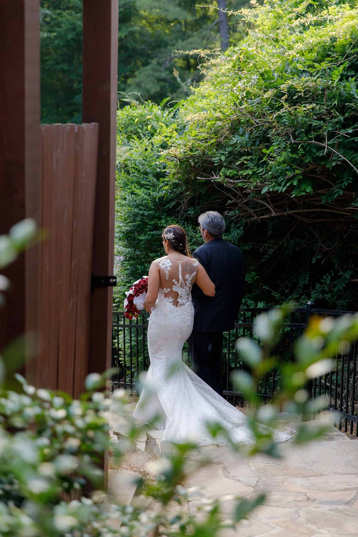 bride and dad begin walk down the aisle