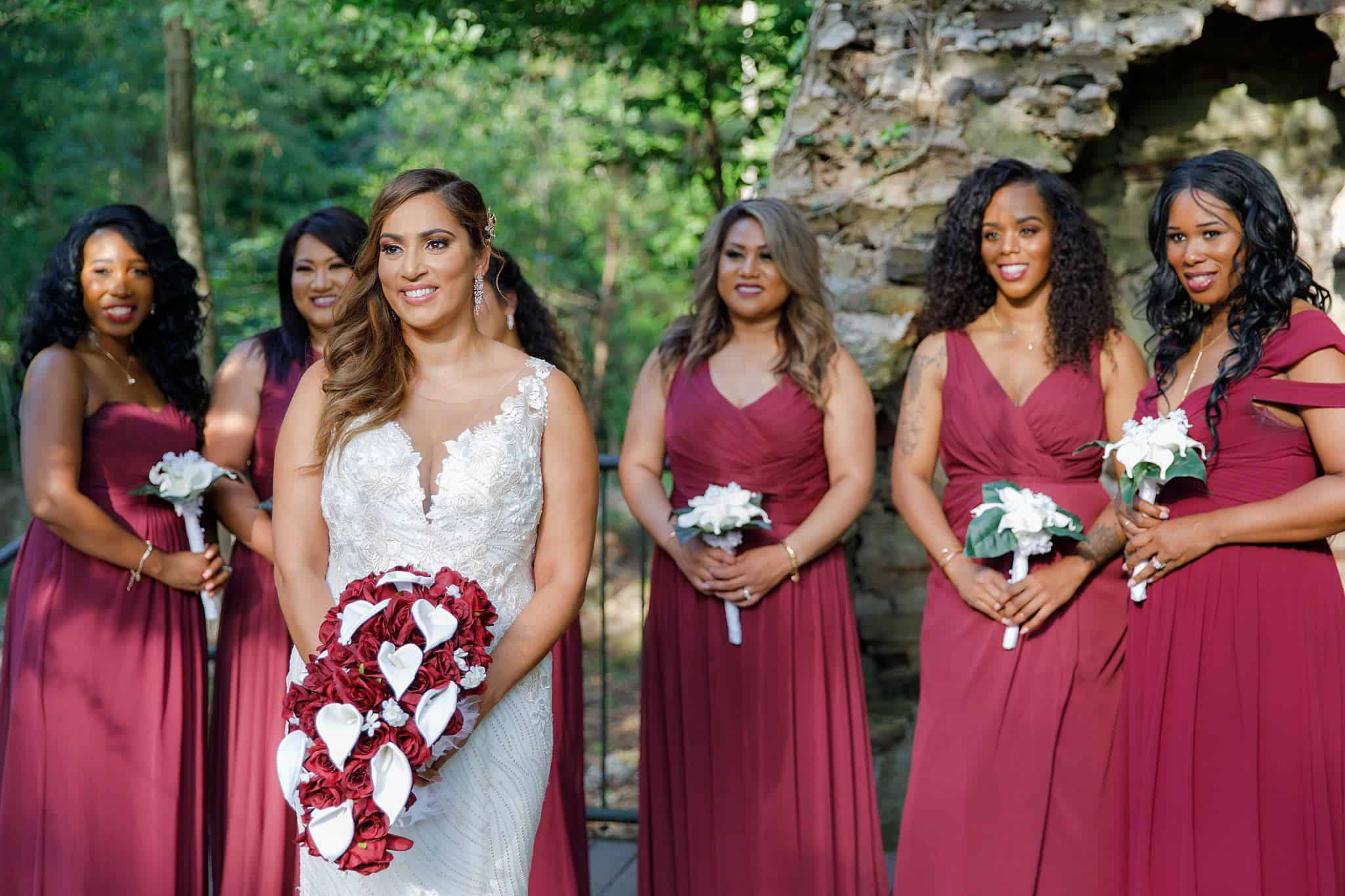 bride with bridesmaids at fireplace