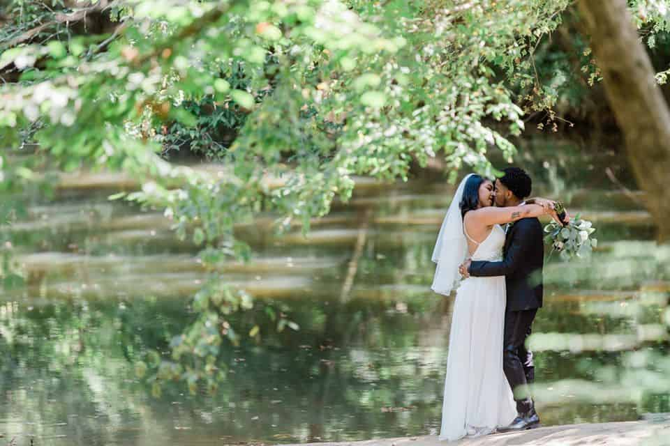 Bride and Groom Embracing on the banks of the Yellow River in Snellville
