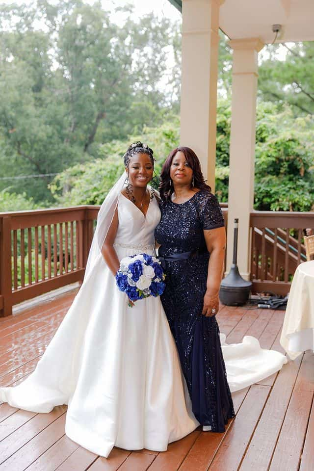 Bride with Mother of the Bride holding bridal bouquet on outdoor deck