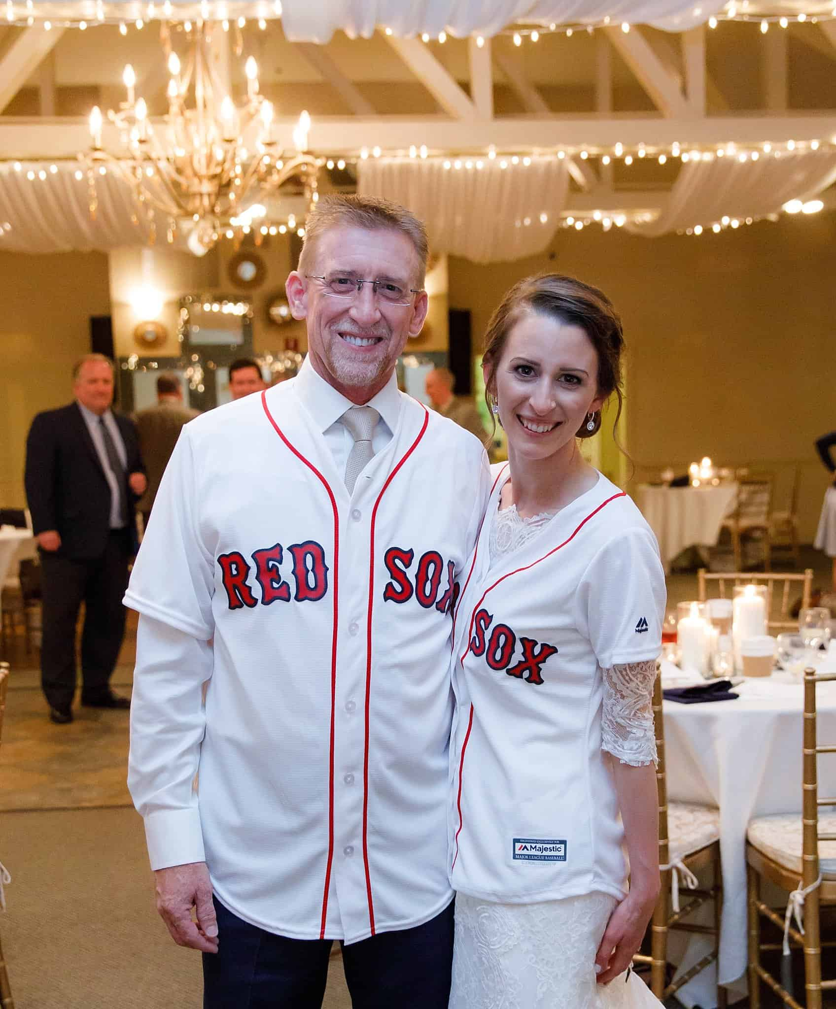 Bride and Groom pose in Red Sox jerseys