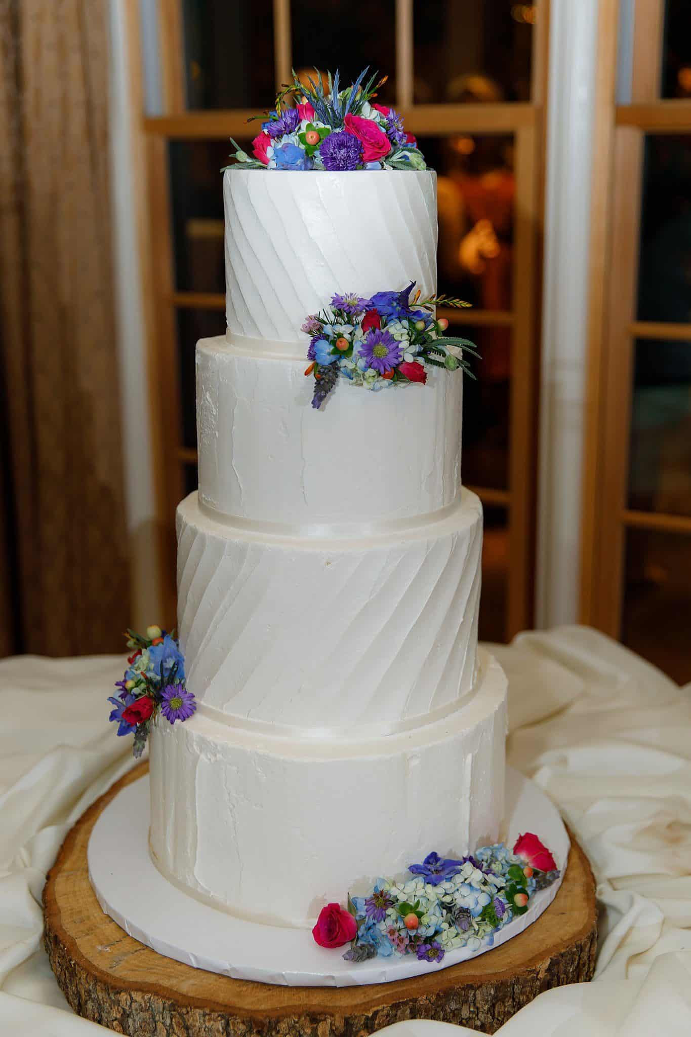 4-tiered wedding cake with colorful flowers