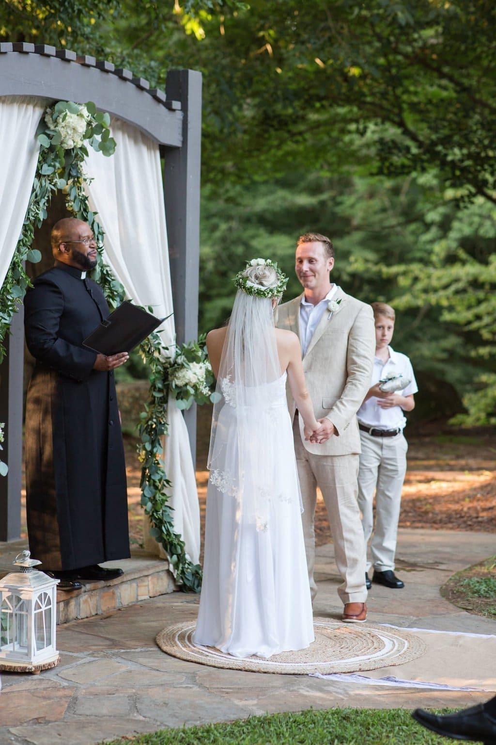 Flower Crown, tan suit, outdoor ceremony