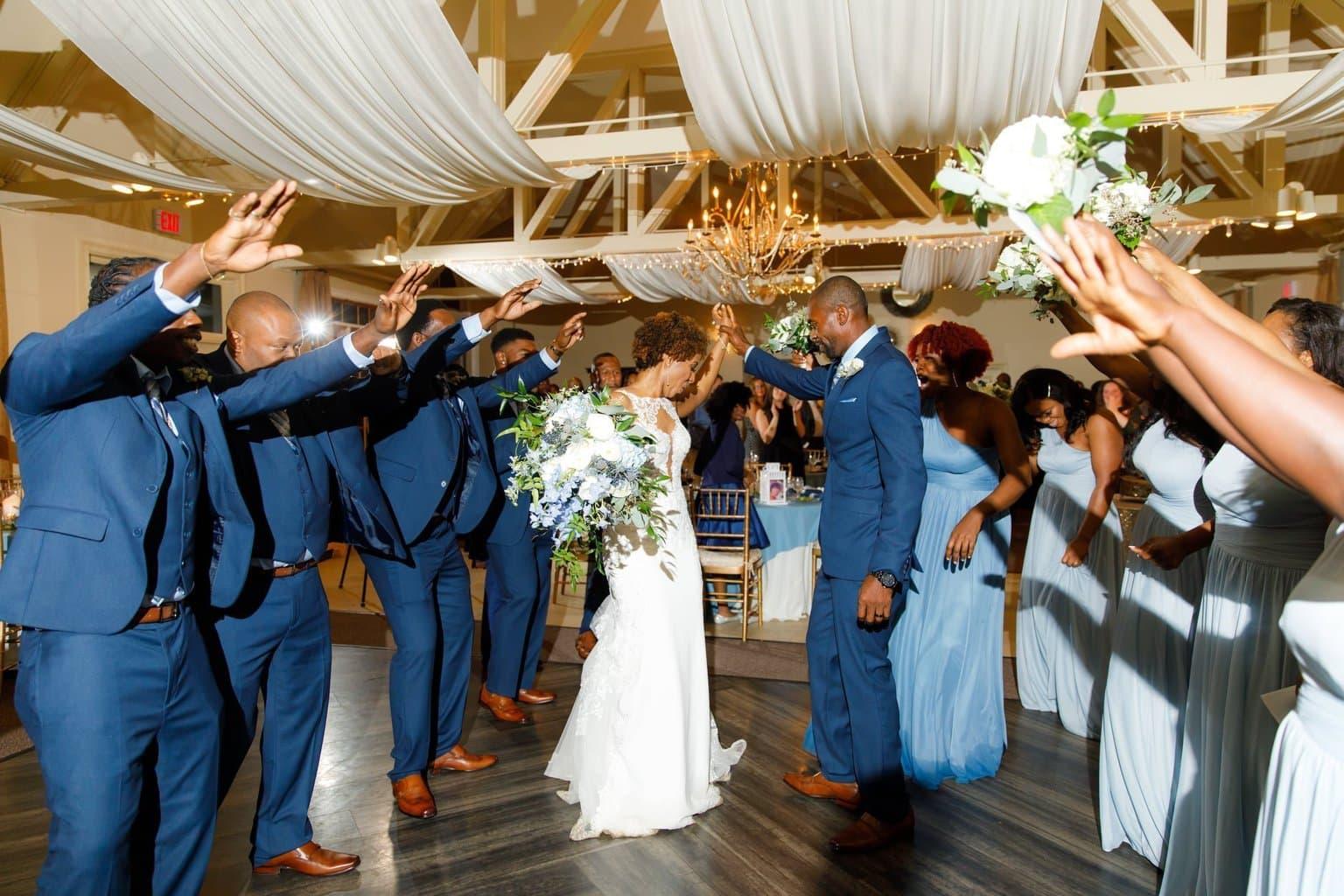 Bride and Groom reception entrance Navy suits, Blue Bridesmaids dresses