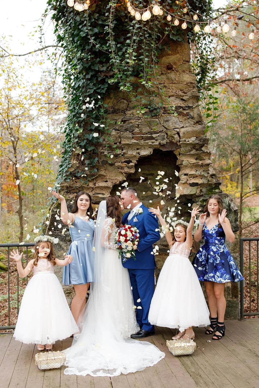 Tossing rose pedals with flower girls