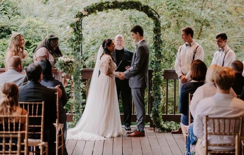 Traditional wedding ceremony back deck
