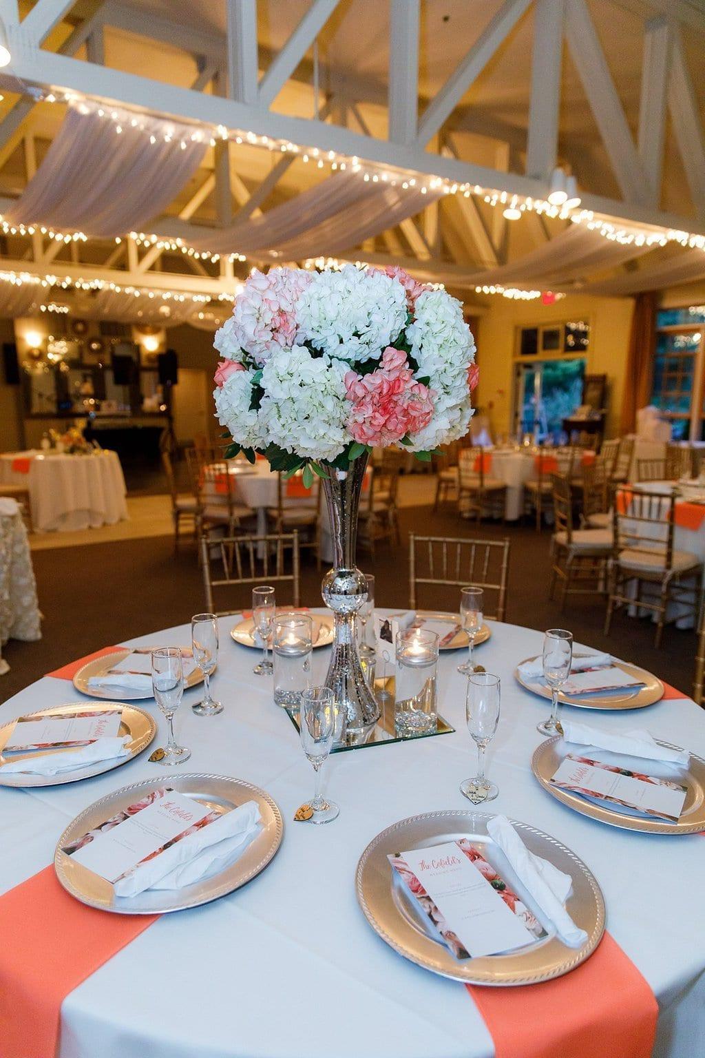 Gold wedding chargers, tall floral arrangement